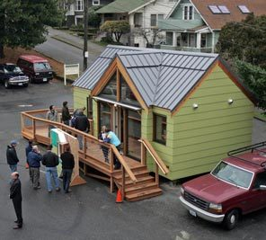 """Photo: GREG GILBERT / THE SEATTLE TIMES    Caption: An exterior view of the energy-efficient modular residence, also known as the """"Mini-B,"""" in the lower parking lot of Phinney Neighborhood Association Center. The house will be there for a few months."""